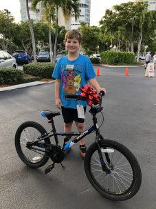 Bike Giveaway for Big Brothers Big Sisters at The Village Shops on Venetian Bay